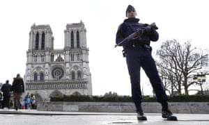 An armed police officer outside Notre Dame