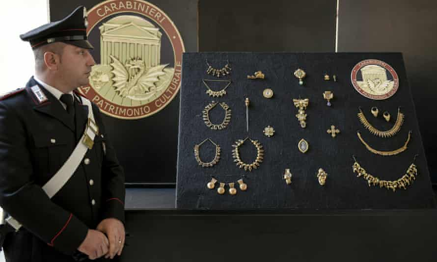An officer stands guard by the recovered jewellery