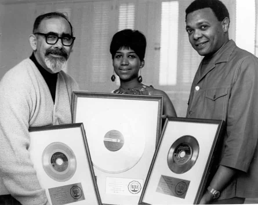 Producer Jerry Wexler, Aretha Franklin and her husband and manager Ted White celebrate a milestone in sales, circa 1968.