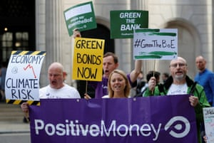 Environmental and banking system protestors demonstrate outside the Bank of England demanding that the bank rule out investment in high-carbon sectors in London, Britain July 11, 2019. REUTERS/Peter Nicholls