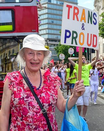 Transgender pensioner Margaret Pepper, 73, holds a placard