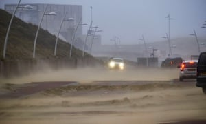Sand is blown on to the road by gales in The Hague.