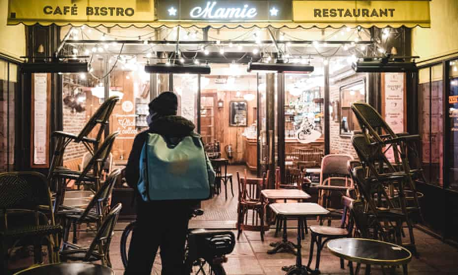 A Deliveroo rider waiting for an order in Paris