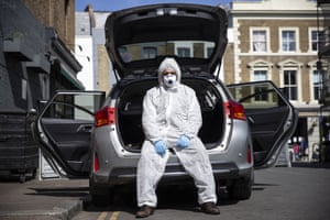 Uber driver Yasar Gorur wears personal protective equipment while cleaning his vehicle in London. Gorur says he wipes down the seats in his car every 2-3 trips and wears PPE whenever he drives.