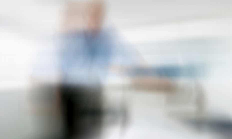 blurry image of a doctor looking down at a patient in a hospital bed