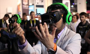 Razer OSVR open source virtual reality for gaming at CES 2015. The adoption of VR will depend on compelling games and content, experts say