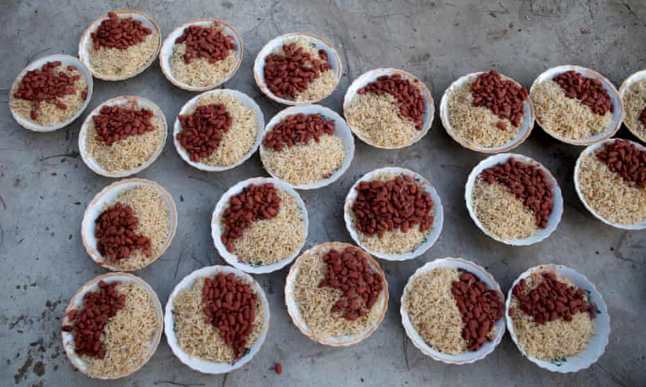 Plates of rice and beans are prepared to be served to people breaking fast at a mosque on the first day of Ramadan in Kabul, Afghanistan.