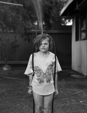 A portrait of Scarlett, the photographer Nina O'Brien's daughter, from a series called Domestic Theatrics. O'Brien describes the series as a 'private porthole' chronicling 'the myriad of keenly felt emotions that are played out on a daily basis' and as 'photos never destined for the family album'.