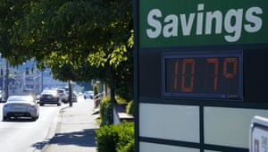 A display at an Olympia Federal Savings branch shows a temperature of 107 degrees Fahrenheit in Olympia, Washington.