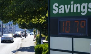 A display at an Olympia Federal Savings branch shows a temperature of 107F on Monday in the early evening in Olympia, Washington.