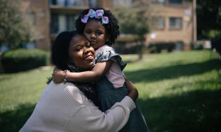 Rashida Taylor with her four-year-old daughter Riley outside of their home in Washington DC on 19 August.