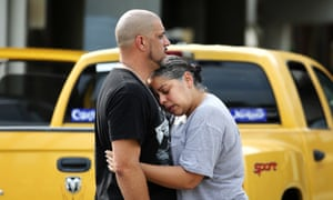 Ray Rivera, left, a DJ at the Pulse Orlando nightclub, is consoled by a friend, outside of the Orlando police department.