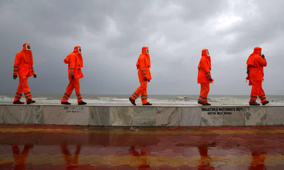 National disaster response workers patrol the shore in West Bengal ahead of Cyclone Yaas.