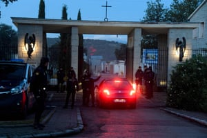 Police officers guard the entrance of the Mingorrubio cemetery