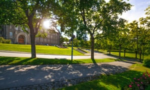 Norwegian University of Science and Technology - NTNU behind trees in Trondheim