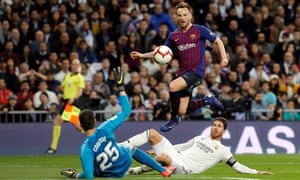 Ivan Rakitic lifts the ball over Thibaut Courtois for the game's only goal.