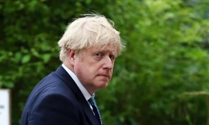 Boris Johnson leaving Downing Street on 14 May