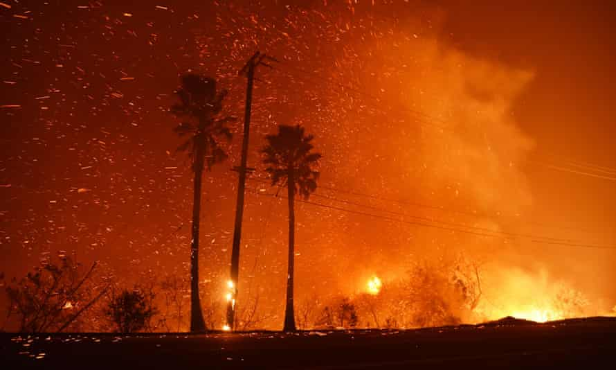 A power line catches fire as the Woolsey fire burns on both sides of Pacific Coast Highway in Malibu, California, on 9 November.