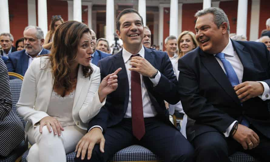 Alexis Tsipras wears a tie for the first time in more than three years in office to symbolise the debt relief deal.