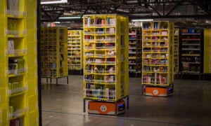 Kiva robots transport goods at an Amazon Fulfillment Center, ahead of the Christmas rush, in Tracy, California in November 2014
