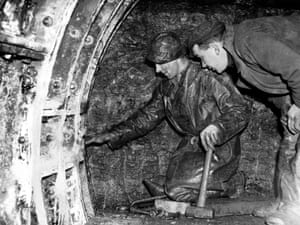 February 1948. Before the tunnel was built the only way for workers to travel between the industrial areas of Jarrow to the south of the Tyne river and Howdon to the north was to take a ferry, or make the long detour to the nearest bridge in Newcastle. Pictured, workmen make a start on the access passage from Jarrow to where the tunnel will begin