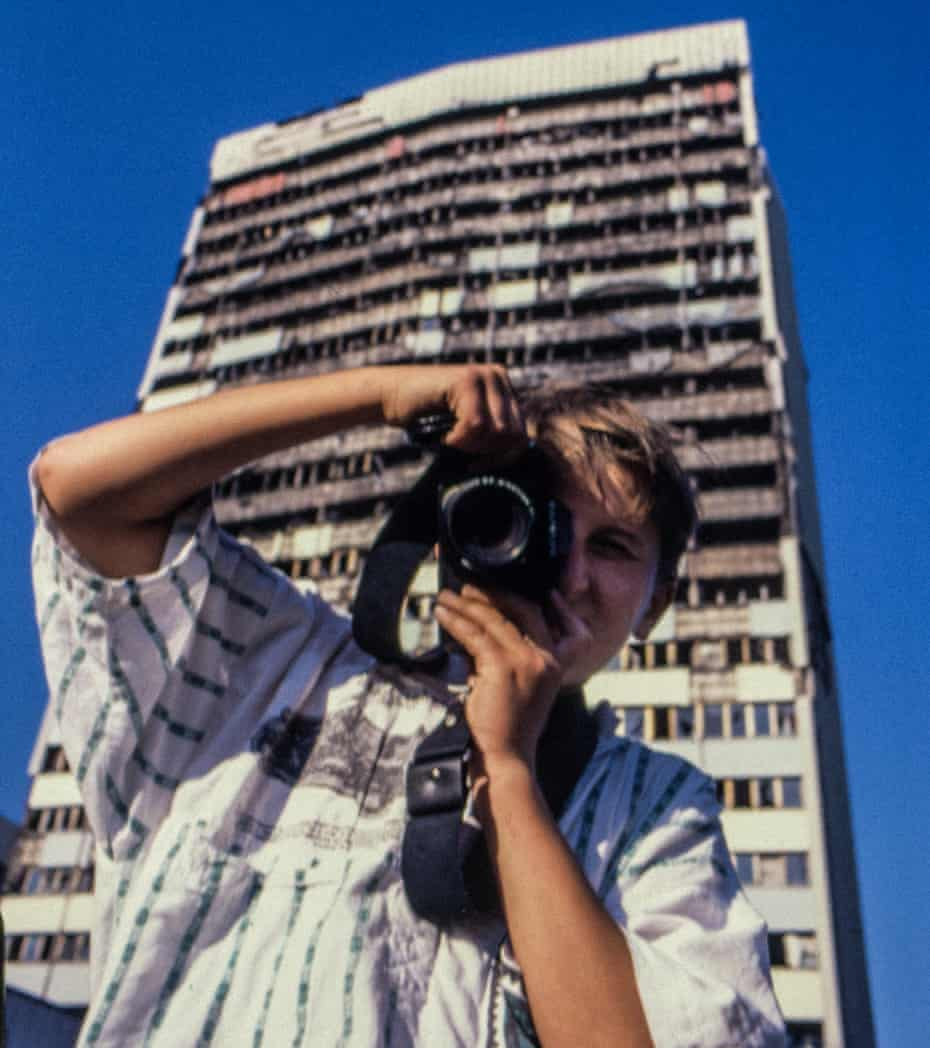 Oggi Tomic aged 13 in front of the destroyed parliament building in Sarajevo, June 1997.