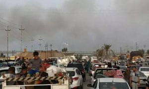 People leave their home town Ramadi on Thursday. Some 2,000 families have already fled.