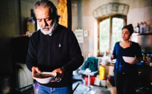 Hovig Samra carries a bowl of soup inside the kitchen of his restaurant in Stepanakert