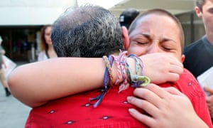 Marjory Stoneman Douglas student Emma González hugs her father after speaking at a rally.
