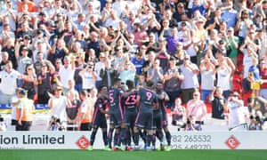 Leeds United players celebrate their second goal at Stoke in front of their travelling supporters.