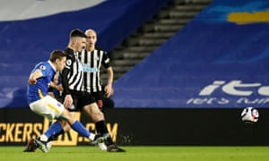 Leandro Trossard of Brighton & Hove Albion scores the opening goal.