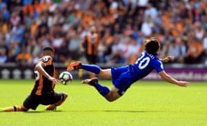 Shinji Okazaki is taken down by Hull City's Curtis Davies.