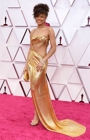 Singer Andra Day is in a cut-out, bandeau-style gown by Vera Wang which looks like an Oscar statuette and judging by the fabric (metal) probably feels like it too. Apparently a welder was involved in its fashioning.