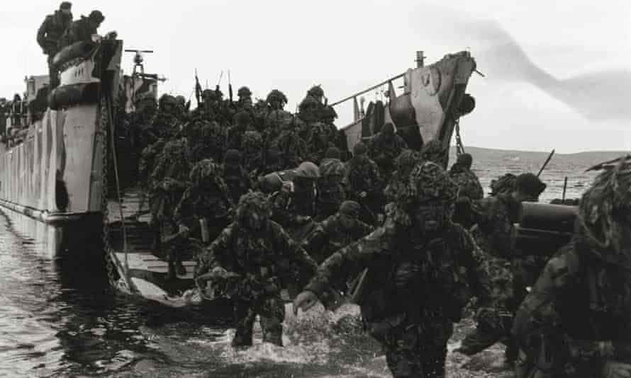 John Shirley's photograph of 42 Commando Royal Marines storming ashore from a landing craft at Port San Carlos on the first day of the British land campaign