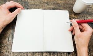 A person with a blank notebook in front of them