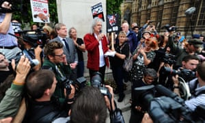Brian May addresses anti-foxhunting campaigners outside parliament.