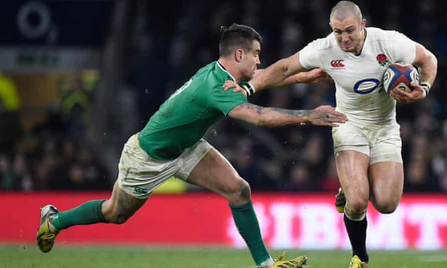 Mike Brown fends off Ireland's Conor Murray.