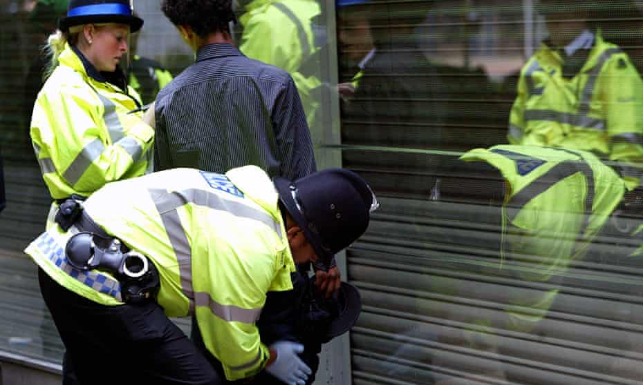 Police search a suspected drug dealer in the northern quarter of Manchester.