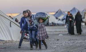 Syrian refugees in a camp on the Turkey-Syria border near Aleppo.