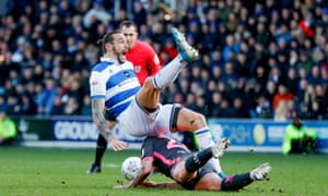 QPR's Geoff Cameron reacts to the challenge by Kalvin Phillips which earnt the Leeds player an early bath.