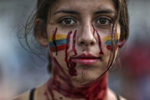 A student performs a play called Who Killed Them during anti-government protests in Cali, Colombia