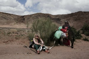 Julie Paterson, a Sinai Trail trip officer, rests with Umm Yasser