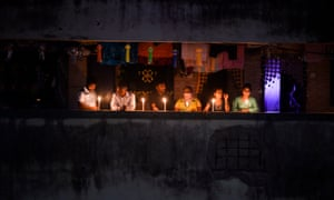 Residents light candles and turn on their mobile phone lights in their balcony to observe a nine-minute vigil called by India's Prime Minister in a show of unity and solidarity in the fight against the coronavirus pandemic in Mumbai on 5 April, 2020.