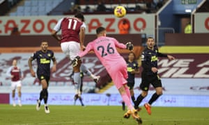 Aston Villa's Ollie Watkins scores the opening goal past Newcastle's goalkeeper Karl Darlow during the English Premier League soccer match between Aston Villa and Newcastle United at Villa Park in Birmingham, England, Saturday, Jan. 23, 2021. (Clive Brunskill/Pool via AP)