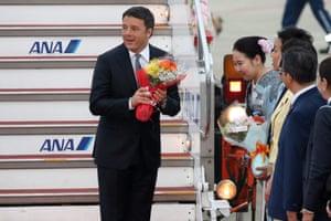 Italian prime minister Matteo Renzi receives flowers at Chubu Centrair international airport.
