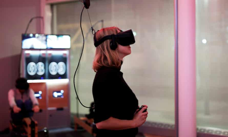 A woman playing a video game using the Oculus Rift VR headset.