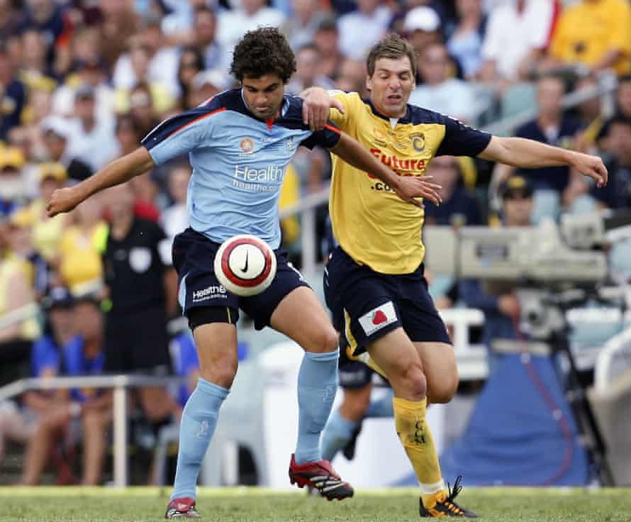 Same but different. Jacob Timpano of Sydney and Stewart Petrie of the Mariners during the 2006 grand final.