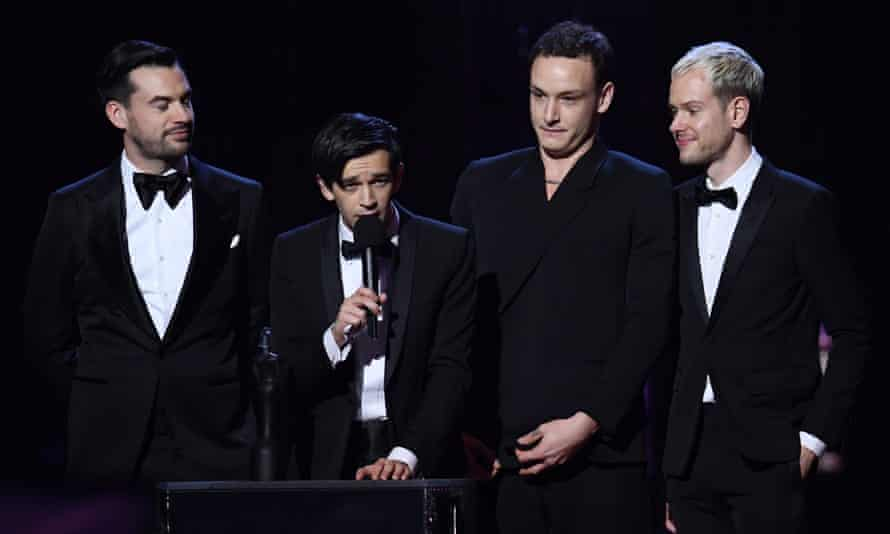 Matty Healy (second from left) accepts the Brit award for best British group, 20 February 2019.