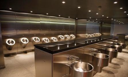 Stainless steel men's public toilet,<br>London, UK.