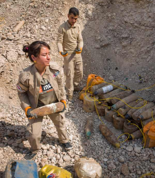 'We are strong and we cannot be defeated': Hana Khider, with an unexploded ordnance found near Sinjar.